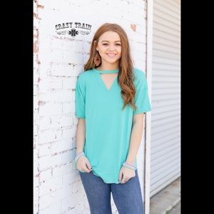 NWT Turquoise Textline V Neck Top